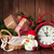 christmas gifts and tree with alarm clock and snowman stock photo © karandaev
