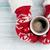 female hands holding hot coffee above wooden table stock photo © karandaev