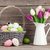 Easter eggs and colorful tulips stock photo © karandaev