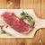 nyers · vesepecsenye · steak · rozmaring · fűszer · vágódeszka - stock fotó © karandaev