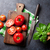 fresh ripe garden tomatoes and basil on stone table stock photo © karandaev