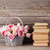 pink tulips bouquet basket and old books stock photo © karandaev