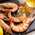 grilled shrimps on stone plate and beer mug stock photo © karandaev