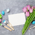 easter eggs tulips and greeting card stock photo © karandaev
