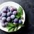 garden plums in plate on stone table stock photo © karandaev