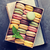 colorful macaroons in a box over book stock photo © karandaev