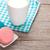 colorful macaron cookies and cup of milk stock photo © karandaev