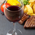 red wine glass and steak with grilled potato corn salad stock photo © karandaev