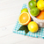 citrus fruits in basket oranges limes and lemons stock photo © karandaev