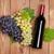 бутылку · виноград · деревянный · стол · вино - Сток-фото © karandaev