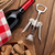 red wine bottle bowl with corks and corkscrew stock photo © karandaev