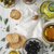 olive oil with bread and olives mix on the white wooden table vertical stock photo © karpenkovdenis