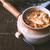 ceramic pot with onion soup on the wooden table horizontal stock photo © karpenkovdenis