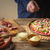 человека · синий · рубашку · домашний · пиццы · кухне - Сток-фото © Karpenkovdenis