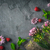 Flowers  , raspberries and mint on the dark stone background stock photo © Karpenkovdenis