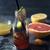 Half-empty bottle with citrus juice on the dark stone background stock photo © Karpenkovdenis