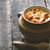 onion soup in the ceramic pot on the old wooden table stock photo © karpenkovdenis