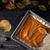 Putting spicy pumpkin puree on the dough for pumpkin pie top view stock photo © Karpenkovdenis