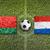 Belarus vs. Netherlands flags on soccer field stock photo © kb-photodesign
