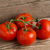 Red tomatoes on wooden background stock photo © kb-photodesign