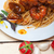 italian seafood spaghetti pasta on red tomato sauce stock photo © keko64
