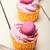 pink berry cream cupcake with macaroon on top stock photo © keko64