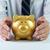 megtakarítás · persely · pénzügyi · üzlet · pénz · kéz - stock fotó © kenishirotie