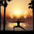silhouette of female in yoga pose in tropical landscape stock photo © kjpargeter