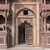 Monumental beige brown front entrance of Jehanghir Mahal Palace in India's Orchha.  stock photo © Klodien
