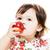 прелестный · ребенка · девушки · еды · красное · яблоко · за · пределами - Сток-фото © kmwphotography