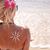 sun cream on the female back on the beach stock photo © koca777