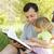 padre · pequeño · hija · Biblia · jóvenes · árbol - foto stock © koca777