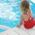 kicsi · aranyos · lány · kék · víz · úszómedence - stock fotó © koca777