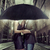 young couple hiding themselves under the umbrella stock photo © konradbak