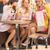 cheerful girlfriends eating fruit ice cream stock photo © konradbak