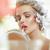 blond woman putting on a lipstick stock photo © konradbak