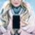 pretty blonde holding a smartphone winter weather stock photo © konradbak
