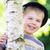fiú · rejtőzködik · arc · portré · kaukázusi · kezek - stock fotó © konradbak