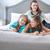 happy family posing in bedroom stock photo © konradbak