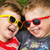 smiling brothers wearing fancy sunglasses stock photo © konradbak