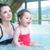 genç · anne · bebek · rahatlatıcı · yüzme · havuzu · sevimli - stok fotoğraf © konradbak