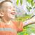 portrait of a little boy walking in the orchard stock photo © konradbak