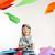 vrolijk · weinig · jongen · spelen · papier · vliegtuig - stockfoto © konradbak
