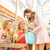 attractive lady showing her girlfriends some shopping stock photo © konradbak