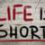life is short concept stock photo © krasimiranevenova