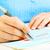 business woman filling document stock photo © kurhan