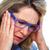 elderly woman having a headache stock photo © kurhan