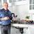 encanador · cozinha · chave · inglesa · homem · casa · fundo - foto stock © Kurhan