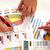 zakenlieden · werken · grafieken · financiële · business · vergadering - stockfoto © kurhan