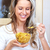 vrouw · eten · granen · jonge · glimlachende · vrouw · vruchten - stockfoto © kurhan